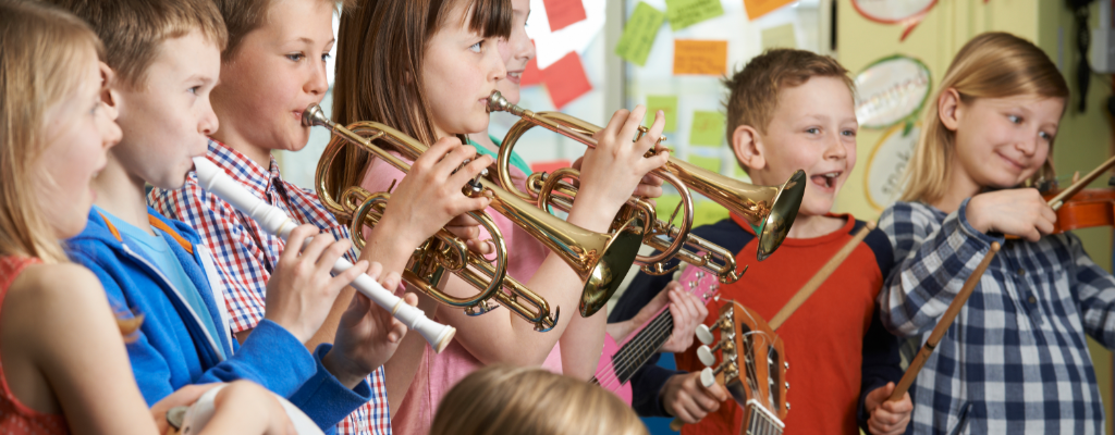 Children happily playing musical instruments